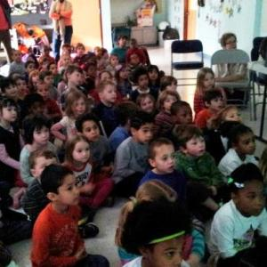 """Ethan at the Montclair Community Pre-K presenting """"An American Boy in China,"""" his slideshow"""