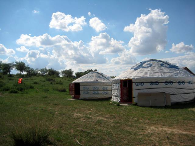 grasslands-yurts-clouds